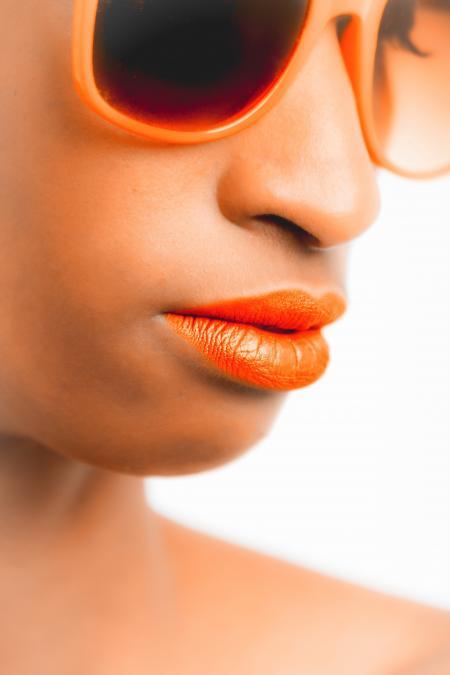 Woman Wearing Orange-framed Sunglasses and Orange Lipstick