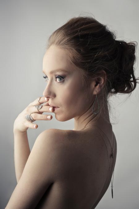 Woman Wearing Silver-colored Earrings Posing