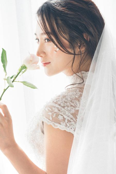 Woman Wearing White Lace Encrusted Wedding Gown and Veil