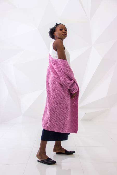 Woman Wearing White Sleeveless Dress and Pink Long Coa