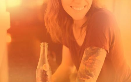 Woman with Drink Smiling - Colorized Hazy Effect