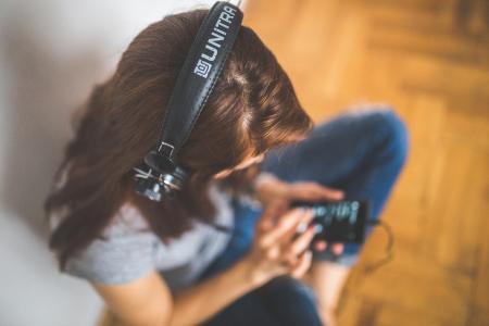 Woman with headphones listening music