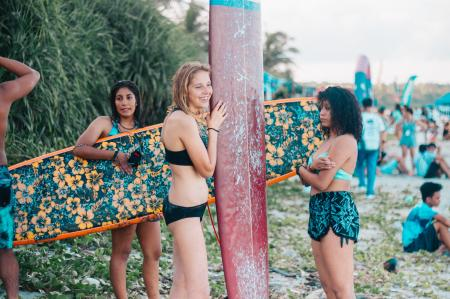 Women Wearing Black While Holding Surf Boards