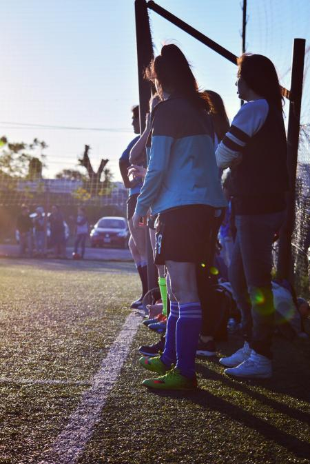 Women Wearing Pair of Blue High-socks