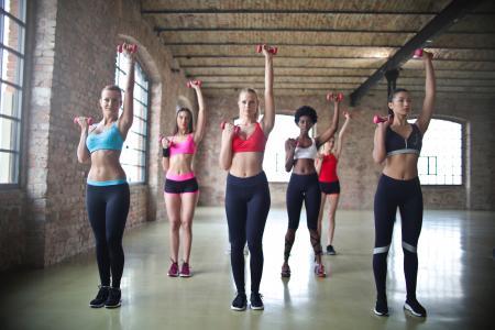 Women's Assorted Sports Bras Raising Their Pink Dumbbells