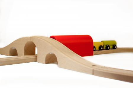 Wooden toy train on railroad