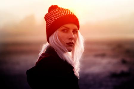 Young Blond Woman with Beanie in Winter