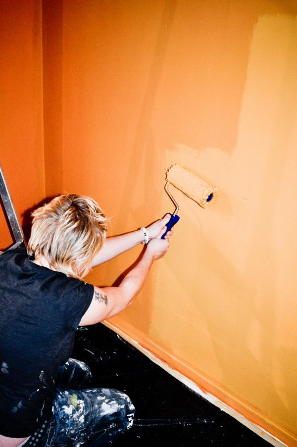 Girl painting wall