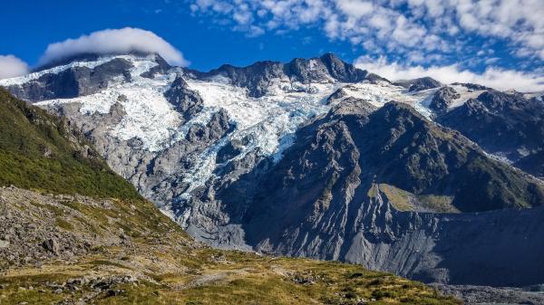 Landscape Photograph of Snowcap Mountains
