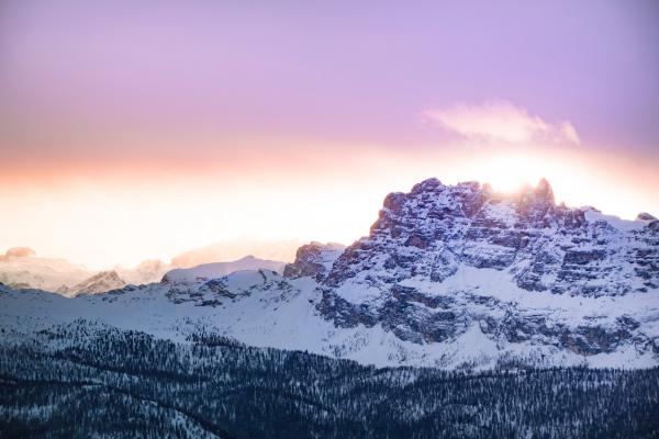 Mountain Cover by Snow Under Orange Sky