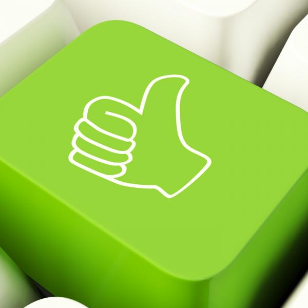 Thumbs Up Computer Key In Green Showing Approval And Being A Fan