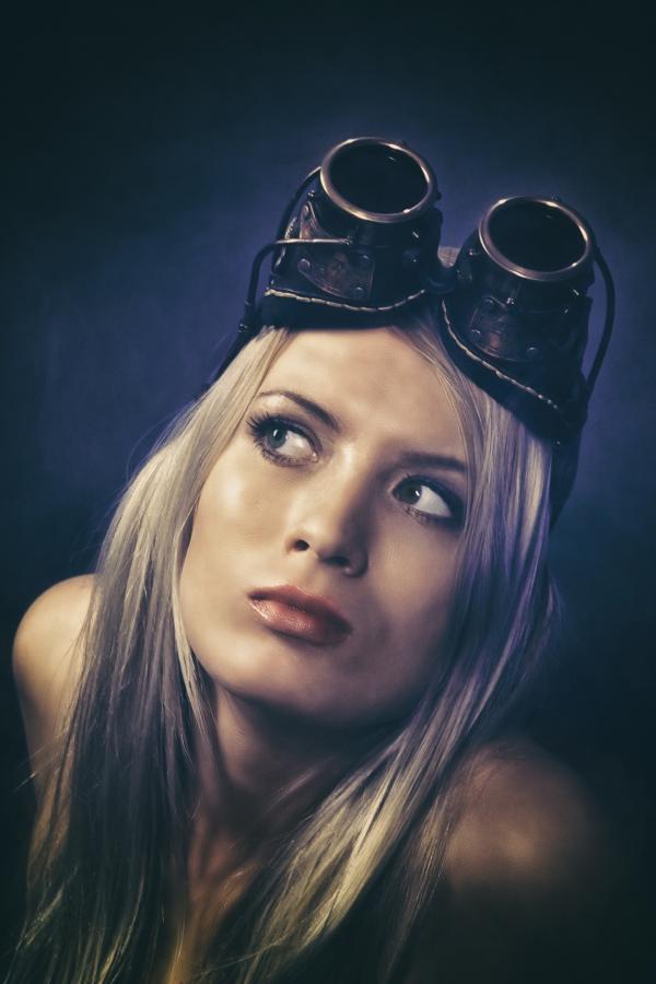 Woman With Blonde Hair Wearing Black Binoculars